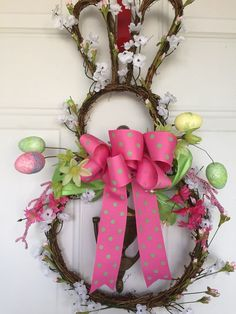 Beautiful vine wreath graced with soft babies breath white flowers and pink tiny rosebuds Pink dogwood flowers and ribbon and Easter eggs Pink Dogwood, Dogwood Flowers, White Flowers, Babys Breath Wreath, Babies Breath, Easter Wreaths, Easter Decor, Deco Mesh Wreaths, Wreath Ideas
