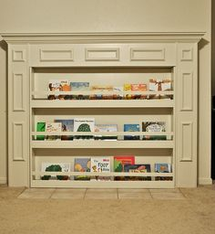 Bookcase to hide the fireplace. Brilliant!