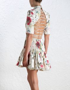 Mischief Corset Laced Dress, from our Spring 16 collection, in Floral printed linen. Pleated detail through front bodice and skirt. Gold bauble trim at neckline, sleeve, and through skirt. High neckline, laced detail back.
