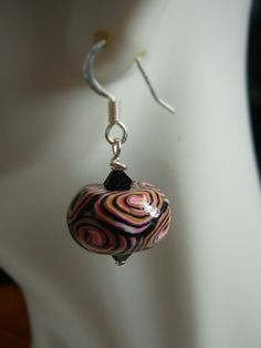 https://flic.kr/p/rF28qx | Polymer bead earrings | Spiral swirl bead made from failed mokume gane sheet