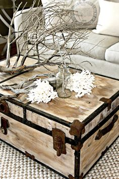 painted trunk by Salvag Dior - who the hell puts a tree branch in their livingroom as a statement piece?