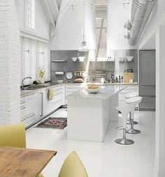 High ceilings with white tiles, gray & great use of textures.