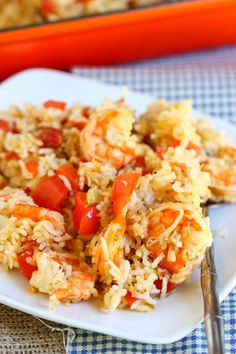 Shrimp and Rice Casserole    1 1/2 lbs raw shrimp, deveined with shells and tails off    2 cups raw white rice    4 tbsp butter    1 can (10.75 oz) Campbell's Cream of Celery soup    1 can (10.75 oz) Campbell's Cream of Chicken soup    1 can (10 oz) Ro-tel (diced tomatoes & green chilies)    1 tsp salt    1 yellow onion, diced    1 red bell pepper, diced    1/2 tsp pepper