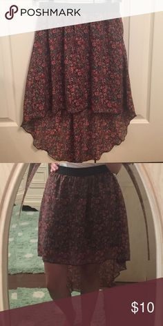 Charlotte Russe Floral Hi-Low Skirt Adorable hi-low skirt with elastic waistband from Charlotte Russe. Size medium, but could fit those who generally wear small. Waistband down to high portion of skirt is 18 inches. Black lining underneath. No stains, rips, or holes. Smoke free home. Charlotte Russe Skirts High Low