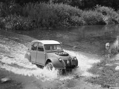 2cv Sahara 4x4.  This is no joke.  These cars competed successfully in the Paris-Dakar race many times.  4 wheel drive was achieved with 2 motors.  One motor in front driving the front wheels and one motor in back driving the rear wheels.