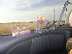 For road trips, stick shower baskets on the windows to organize toys, snacks, and more for kids