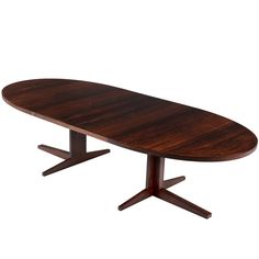 Oval Dining Table in Rosewood   From a unique collection of antique and modern dining room tables at https://www.1stdibs.com/furniture/tables/dining-room-tables/