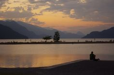 Playing the Guitar and watching the sun set at Harrison Lake, in Harrison Hot Springs
