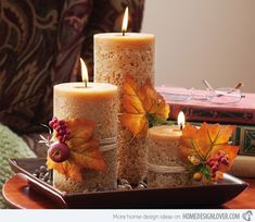 Traditional Candle Centerpiece Ideas - For a different look, add embellishments to your decor. Style your candles with ribbons, leaves or other accessories apt for the season or holiday. (Found at http://www.amazon.com/Autumn-Harvest-Cinnamon-Candlescape-Collections/dp/B005S8PNX8 )