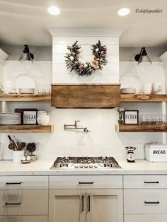 Shiplap hood, whites and woods make for a beautiful farmhouse kitchen. For more farmhouse inspo follow @shiplapaddict on Instagram!