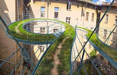 This unexpected meandering green pathway extends far beyond the limits of this building.