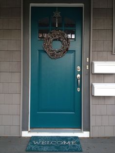 Front Door Color For Grey House With Black Shutters.Exterior House Color Trends Amykranecolor Com. What Your Front Door Color Says About Your Home Sina . Front Door Redo Using Faux Wood Grain Technique Living . Home and Family Teal Front Doors, Teal Door, Front Door Paint Colors, Exterior Paint Colors For House, Painted Front Doors, Paint Colors For Home, The Doors, Paint Colours, Blue Colors