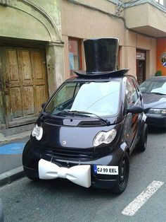 Car decorated with bow and hat.