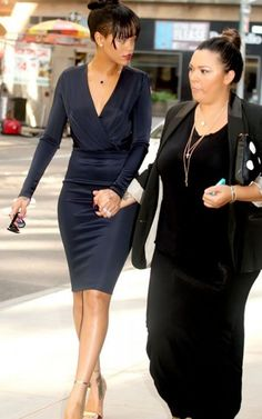 Rihanna has a very sophisticated look in a navy dress with a deep neckline