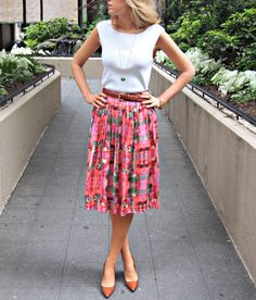 Mid-length skirts are a good option for a more modest look. The modern and simple cut of the top as well as the pointy heels keep it from looking frumpy.
