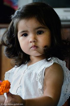 Little girl from Laos, she's so cute.