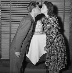 Judy Garland giving a kiss to Mickey Rooney on his 21st birthday. <3