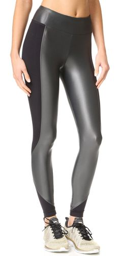 curve crop leggings by KORAL ACTIVEWEAR. Matte and lustrous panels lend dimension to these cropped KORAL ACTIVEWEAR leggings. Small pocket at wide, double lay...