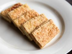 Great tofu—tofu with a tender center surrounded by a well-seasoned, crisp crust—is one of the most satisfying bites of food I can think of, a food that can and should be appreciated by all serious eaters, no matter their diet. Here's how to cook tofu so good even tofu-haters might come around. First we're going to talk about how to shop for tofu, then we'll talk about how to crisp up plain slices of tofu, and finally we'll figure out the best way to prepare tofu for stir-fryin...
