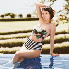 Your escape to paradise wouldn't be complete without this chic one-piece, featuring the Izabal palm print on top and bold black-and-white stripes on the bottom.