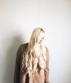 Long, blonde wavy hair.