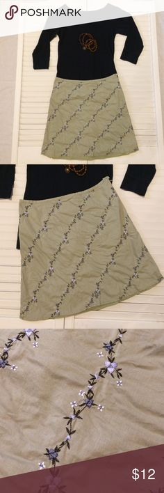 American Eagle Outfitters Embroidered Skirt AE Skirt. Light olive. Beautiful embroidered flower vine detail in dark green/ bluish-violet- gray & white colors. Side zip & button closures. Gently used, no stains or tears. Very cute. American Eagle Outfitters Skirts Mini