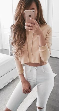 Crop Top Outfits: Pink cropped sweatshirt, white ripped jeans #pink #croptop #outfits #trendy