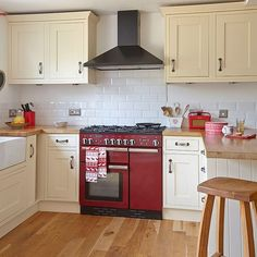 Neutral kitchen with red range cooker | Kitchen decorating | Style at Home | Housetohome.co.uk