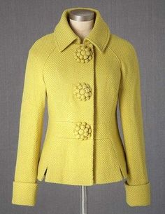 Fifties Jacket in Sulphur at Boden Clothing.  I love this jacket in the bright unexpected yellow along with a beautiful weave-texture and rosette buttons give this jacket a feminine retro look!