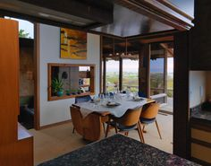 A Contemporary Beach Retreat on California's Central Coast Asks $2.3M - Photo 4 of 10 - The dining room also enjoys bay views.