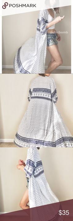 """AVA bohemian summer long duster Summer long flare kimono duster. In off white and navy prints. Maxi long duster. Coachella style. Size S : busts 44"""", length 53"""". Size M:length 54"""". Size L: length 55"""". 👉🏼Follow me on 📸INSTAGRAM: @chic_bomb and 💁🏻📘FACEBOOK: @thechicbomb CHICBOMB Jackets & Coats"""