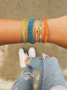 The Dreaming Outloud Pack is named after one of our very fave Instagram influencers! Hailey's Instagram is full of the most amazing travel and style photos, making her the perfect person to design our newest adventure-ready wrist. This set of five bracelets perfectly captures the bold colors and boho feel of her gorgeous feed, and features dreamy designs that give off a free-spirit sorta vibe. #livefree #puravidabracelets #dreamingoutloud #bracelets #sunflower