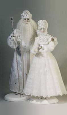 Father Frost and Snow MaidenFather Frost Biscuit porcelain. Real silk, viscose, velvet. Orenburg knitted downy shawl. Traditional Russian Vologda laces. Silk braid. Srtasses, beads.Hand-painting. Limited edition of 50; 25,5 tall Snow Maiden Biscuit porcelain. Real silk, artificial silk, gas. Orenburg knitted downy shawl. Traditional Russian Vologda laces, hand embroidery with glass-beads.