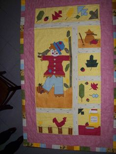 A quilt with scarecrow