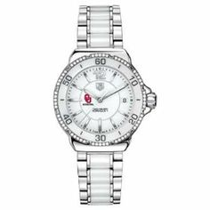 """Oklahoma Women's TAG Heuer Formula 1 Ceramic Diamond Watch by TAG Heuer. $2995.00. Classic American style by M.LaHart. Officially licensed by the US Merchant Marine Academy. University of Oklahoma TAG Heuer women's Formula 1 ceramic watch with 60 radiant diamonds. Elegant dial with the Oklahoma logo and """"Oklahoma"""" underneath.Larger sized, polished steel case (37mm diameter). White ceramic bezel inset with 60 Top Wesselton diamonds. Stainless steel and ceramic brac..."""