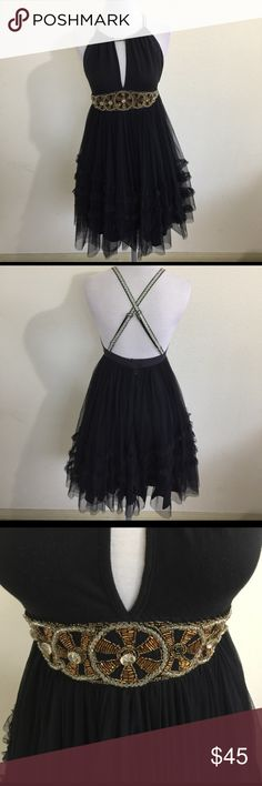 """Free People Black Beaded Tulle Dress, size 4 NWOT Free People Black Beaded Tulle Dress in size4, NWOT. Feautures a full skirt that is just perfect for dancing. Skirt is fully lined and has 2 eye hooks and snaps plus a zipper closure. Straps are adjustable. As pictured with the straps, the dress measures 33"""" from shoulder to hem. Part of the tag and extra beads in a small bag are attached. Never worn, please ask if you have any questions. Free People Dresses"""