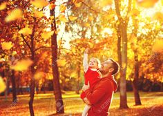 45241189-Happy-family-father-and-child-daughter-on-a-walk-in-the-autumn-leaf-fall-in-park-Stock-Photo.jpg (1300×927)
