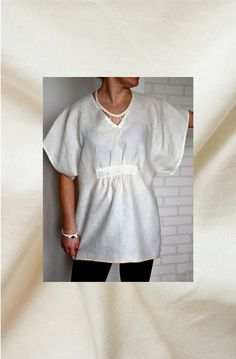 Creamy white linen blouse.  Blouse has V-neck and half length sleeves.   Very…