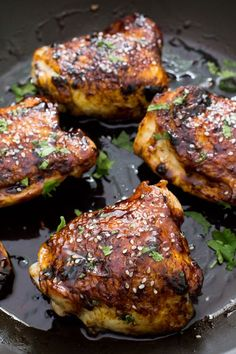Sticky Tender Asian Chicken Thighs smothered in a sweet and spicy Asian inspired sauce. Juicy, tender and loaded with flavor!