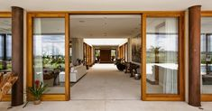 Decor between rustic and modern. By architect Erick Figueira de Mello (In Portuguese) Wooden Sliding Doors, Feng Shui House, Living Room Windows, Interior Decorating, Interior Design, Small House Plans, Modern House Design, Door Design, Luxury Homes