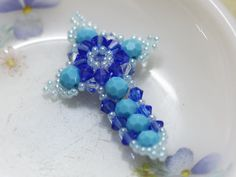 This is the quick tutorial on Cross charm, requested by Bren. But I believe it'll be good to share here too, not to mention I did not have any update for month now. lol Materials: - Bicone crystals 4mm. (Sapphire, Light Azore) - Round crystals 6mm. (Turquoise) - Seed beads 11/0 - Threads If…