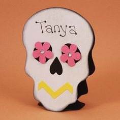 It is easy to create a stand up place cards for your Halloween or Day of the Dead Celebration. Just use a simple folding technique