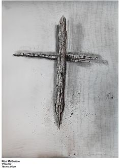 """Ron McBurnie, """"Phoenix"""" 2014he drawing was made from two charred pieces of wood that I gathered from the Nt Stromlo site in the ACT after the devastating fires that happened there. The pieces drawn as a cross were originally meant to be a memorial to people who had lost their homes and belongings and sometimes loved ones in bush fires."""
