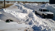 28, 2015 photo provided by Bill Kshir shows a buried Ford Fusion, left, outside of Clovis, N.M. a day after a record snow storm swept New Mexico. Jimmy and Betty Anderson, two newspaper carriers with Clovis Media, Inc., were buried in a 12-foot snow drift for nearly 20 hours until a tractor driver found them Sunday, Dec. 27. (Bill Kshir via AP)