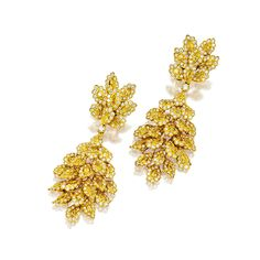 PAIR OF YELLOW DIAMOND AND DIAMOND PENDENT EAR CLIPS The cluster earrings composed of numerous marquise-shaped yellow diamonds surrounded by brilliant-cut diamonds altogether weighing approximately 4.90 and 5.20 carats respectively, mounted in 18 karat yellow gold, pendant detachable.