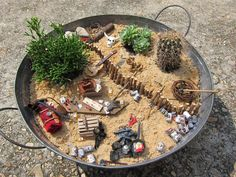 Desert/cowboy themed Fairy Garden. Who knew of fairy gardens. Maybe Susan will help me create one/some, after 2013 breaks!