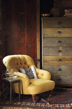 mmm. lovely wood tones. rustic. gold chair.