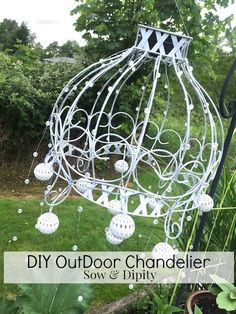 Turn an old hanging wire basket into a gorgeous solar outdoor chandelier