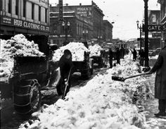 Men use shovels to fill dumptrucks at Southwest Second and Alder Street, in February 1937. More than 34 inches of snow fell in Portland during the winter of 1936-37. Oregon Historical Society #SnowLandia #Snowpocalypse