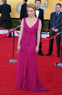 Dianna Agron wore a bright fuchsia Carolina Herrera dress with a ruffle-front and pretty braided updo.